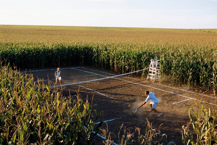 Photo: A game of tennis on a court carved from a cornfield.
