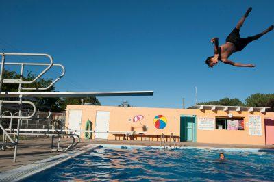 Photo: A boy jumps of the diving board at Crofton pool, Crofton, Nebraska.