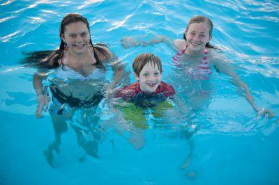 Photo: A group of kids in the Crofton pool, Crofton, Nebraska.