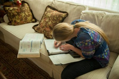 Photo: A young girl works on her homework, Lincoln, Nebraska.