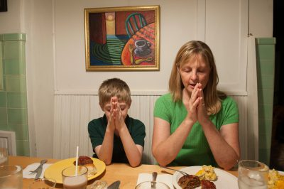 Photo: A mother and son pray before dinner, Lincoln, Nebraska.