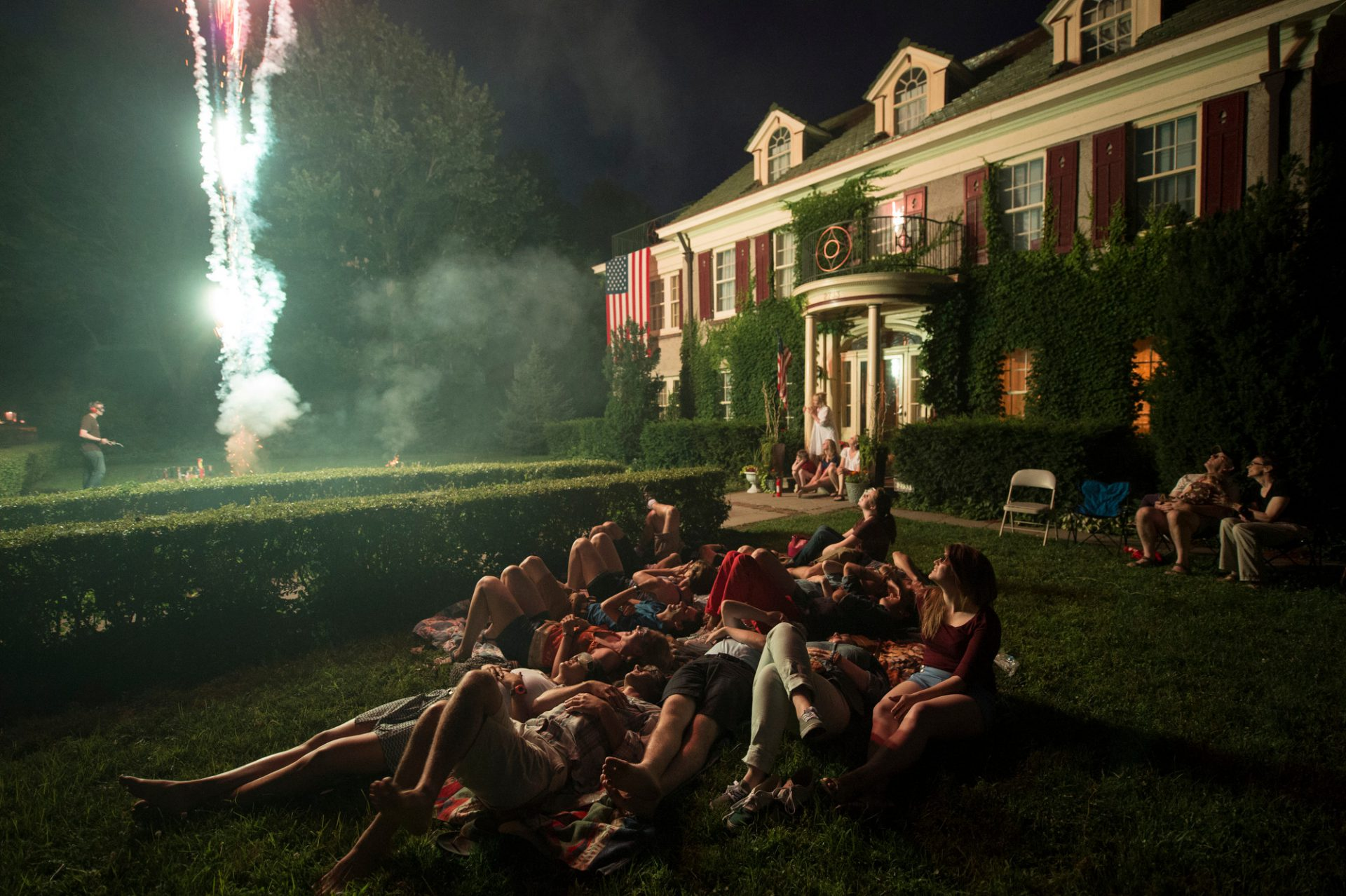 Photo: A group of people gather to watch fireworks and celebrate the Fourth of July in Lincoln, Nebraska.