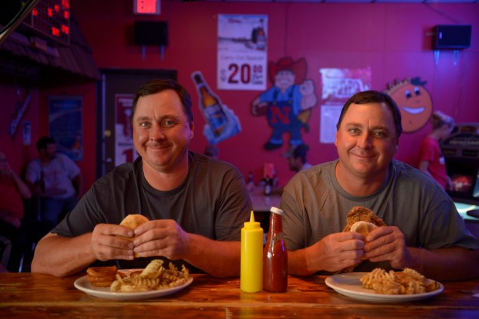 Photo: Twin farmers enjoy lunch at Mulligan's Bar in Oxford, NE.
