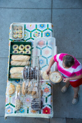 Photo: A woman displays her baked goods at the Farmer's Market in the historic Haymarket district of Lincoln, Nebraska.