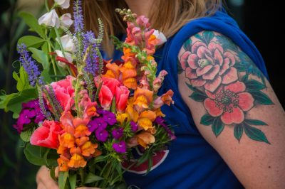 Photo: A woman holds flowers at the Farmer's Market in the historic Haymarket district of Lincoln, Nebraska.