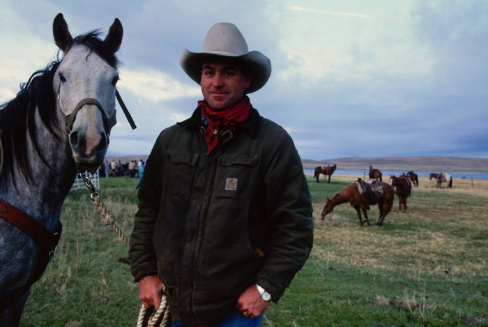Photo: A rancher takes a break during a day of branding on a ranch in the Nebraska Sandhills.