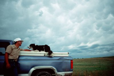 Photo: Carl Simmons with a cattle dog on his ranch near Valentine, NE.