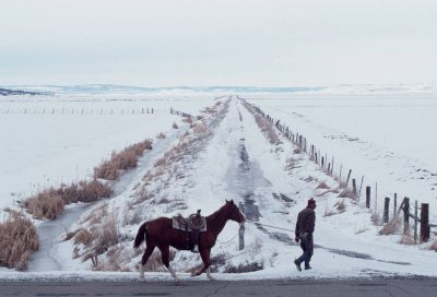 Photo: A rancher leads his horse past a frozen irrigation ditch near Likely, California.