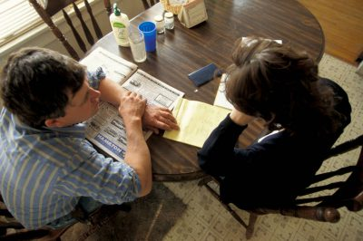 Photo: A Nebraska farm family analyzes their budget at the kitchen table and tries to figure out how to fit everything in.