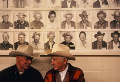 Photo: Don Flynn and Jim Owens sit and talk at the Shasta Livestock Auction in Cottonwood, northern California.