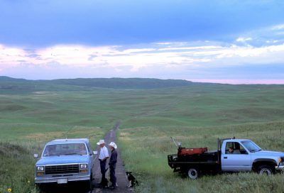 Photo: Ranchers stop to talk in the Nebraska Sandhills.