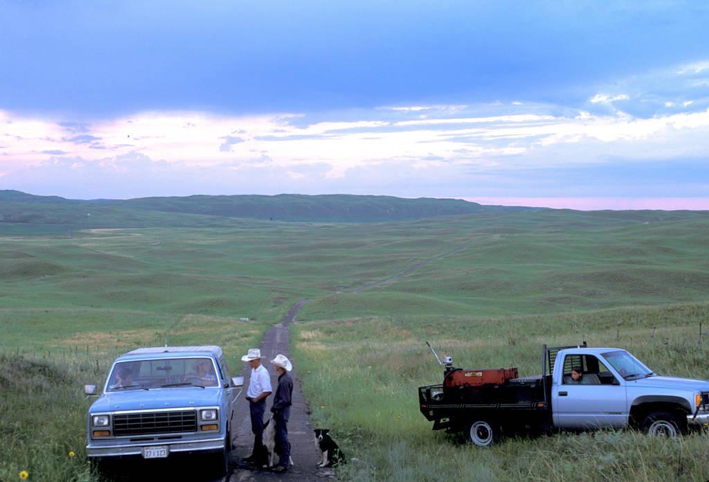 Photo: Ranchers stop to talk in the Nebraska Sandhills.