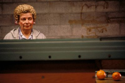 Photo: Woman on an orange quality check line in Northern California.