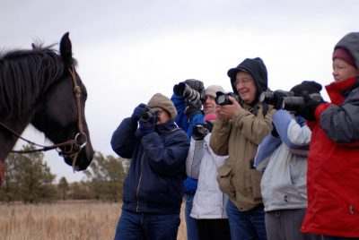 Photo: Tyson Cox and his horse pose for some photographers in the Nebraska Sandhills.