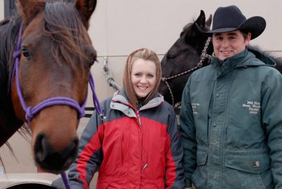 Photo: Tyson and Rachel Cox, a young ranch couple in the Nebraska Sandhills, pose with their horses.