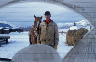 Photo: Rancher Mark Ellis with his horse.