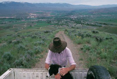 Photo: Rancher Mark Ellis with his border collie near Salmon, Idaho.
