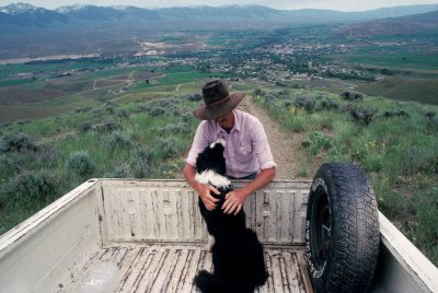 Photo: Rancher Mark Ellis with his border collie near Salmon, Idaho.