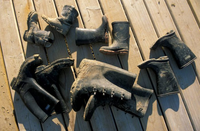 Photo: Muddy boots dry out on the porch at the Sandal family ranchnear Howes, SD.