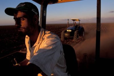 Photo: A migrant worker plows fields in Brazil's Pantanal.