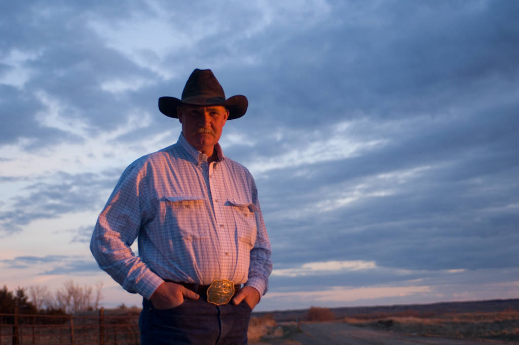 Photo: A rancher poses as the sun sets over the Switzer Ranch in the Nebraska Sandhills.