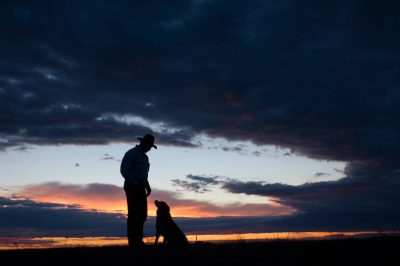 Photo: A rancher and his dog on the Switzer Ranch in the Nebraska Sandhills.