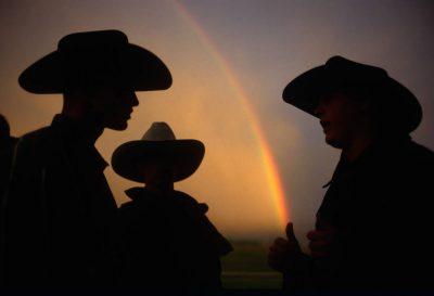Photo: Cowboys talk after a rain storm near Sandy, UT.