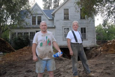 Photo: A father and son work on digging a basement for a run down farm house in Nebraska.