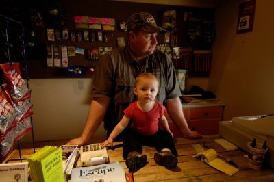 Photo: A father spends time with his child at Calamus Outfitters in Gibbon, Nebraska.