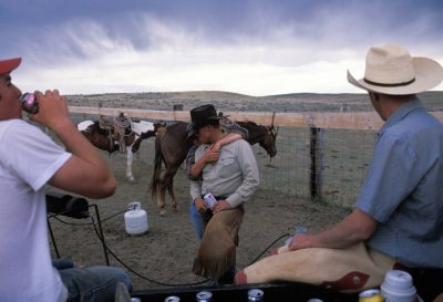 Photo: During a break from branding cattle at a ranch in Gillette, Wyoming, a woman holds her husband as he drinks a beer.