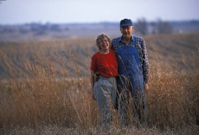 Photo: A farmer and his wife stand in a field in rural Nebraska.
