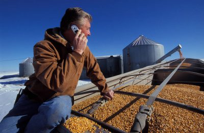 Photo: A farmer talks on a cellular phone at his farm near Fairfax, Missouri.