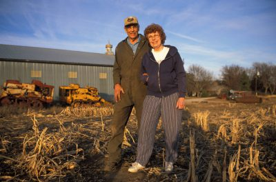 Photo: A couple stands in a harvested corn field in Nebraska.