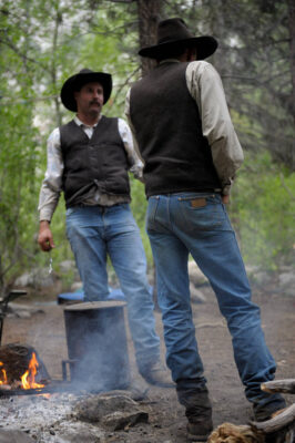 Photo: Cowboys start a campfire in the Kings Canyon National Park in the Sixty Lake Basin, California.