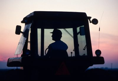 Photo: A farmer in the cab of his tractor in rural Flatville, IL.