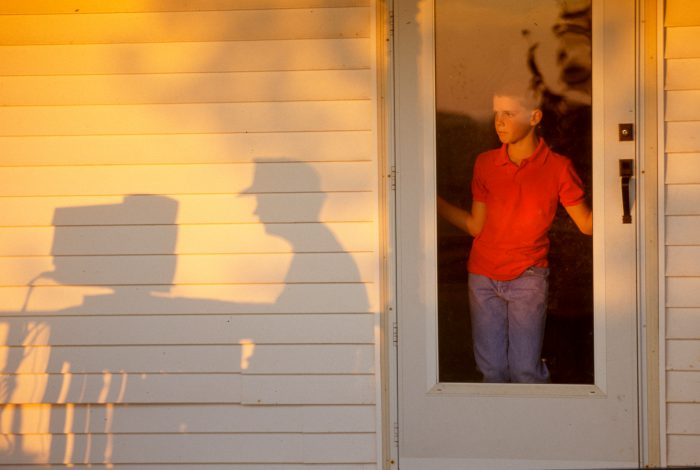 Photo: A boy watches his father use a computer on a farm in Flatville, IL.