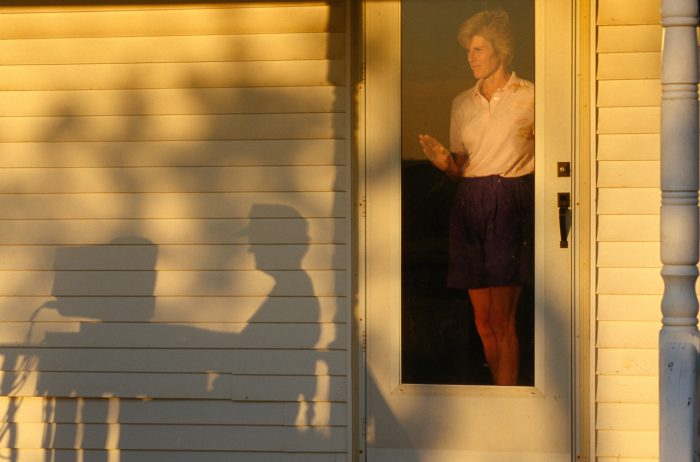 Photo: A wife watches her husband use a computer on a farm in Flatville, IL.