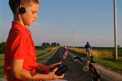 Photo: A boy listens to music on a portable tape player in rural Flatville, Illinois.
