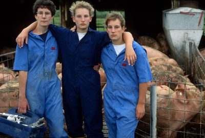 Photo: Mother and daughters pose for a portrait after working hogs at the Montgomery farm near Bennet, Nebraska.