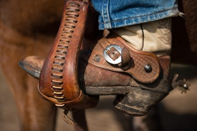 Photo: Detail shot of an elementary age boy's cowboy boot in a stirrup.