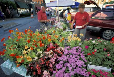 Photo: Flower booth at the Farmer's Market in Lincoln, Nebraska's Haymarket District.