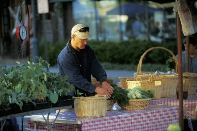 Photo: Produce booth at the Farmer's Market in Lincoln, Nebraska's Haymarket District.