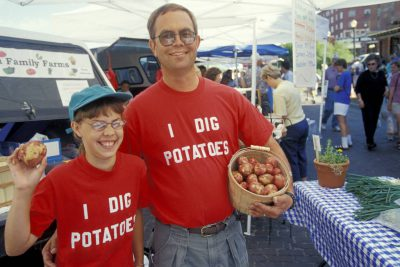 Photo: A family at their potato stand in the Farmer's Market in Lincoln, Nebraska's Haymarket district.