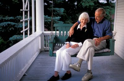 Photo: A couple sits on a porch swing in Lincoln, Nebraska.