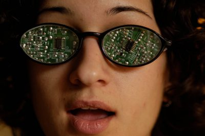 Photo: A young woman sports a pair of high-tech glasses made of circuit boards.