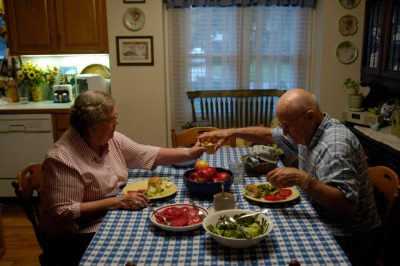 Photo: A man and a woman share dinner at their home in Elkhorn, NE.