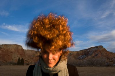 Photo: A woman flips back her hair at the Ghost Ranch outside Santa Fe, New Mexico.