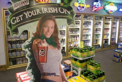 Photo: Cardboard cut out girls advertise alcoholic drinks.