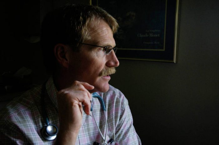 Photo: A doctor sits in his office in Lincoln, Nebraska.