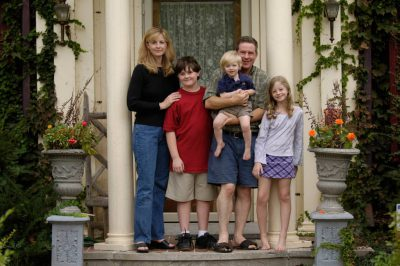 Photo: The Sartore family gathers in front of their home for a group portrait.